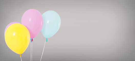 holiday helium balloons isolated on grey background, birthday concept