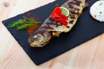 Baked trout with rice, grilled bell pepper