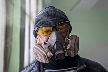 Portrait of a man in a respirator, free space.