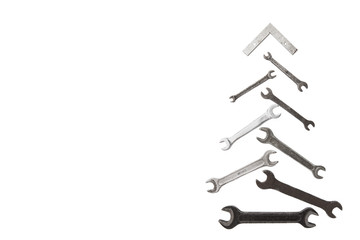 christmas tree figure made of old rusty wrench isolated on white