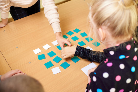 children play educational game with cards, mental arithmetic, study