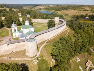 Izborsk medieval Russian fortress (kremlin) with a church. Aerial drone photo. Near Pskov, Russia. Birds eye view