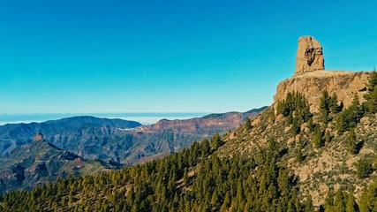 aerial drone image of beautiful stunning landscape view off the Roque Nublo rock formation and plateau at Gran Canaria Spain with a valleys and many small peaks on a sunny day