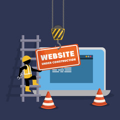 website under construction with laptop
