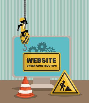 website under construction with desktop computer