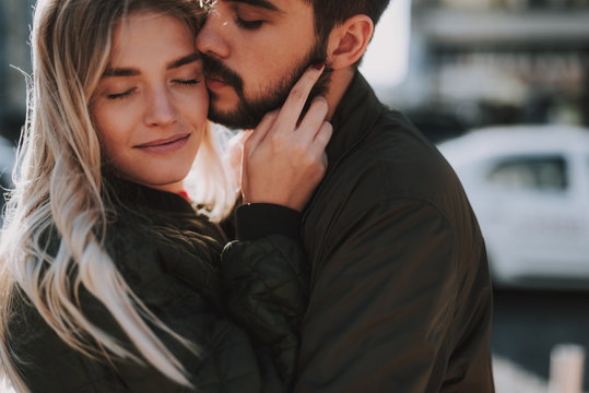Beautiful loving couple cuddling on the street