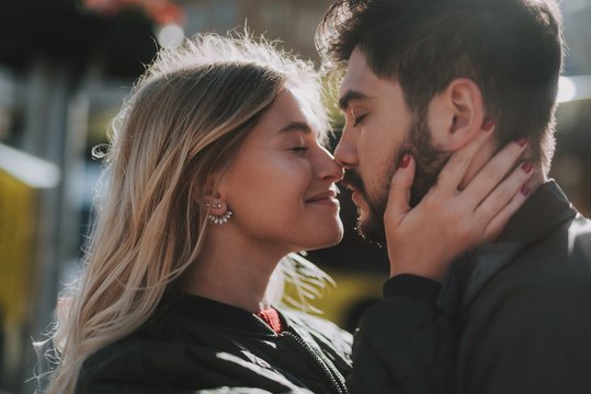 Loving couple touching noses on the street