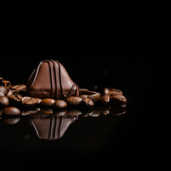 candy, chocolate, filler, cream, coffee  (Black background). food background. copy space