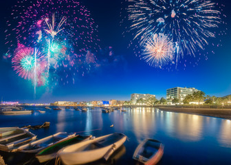 Beautiful fireworks above San Antonio beach on Ibiza, Spain