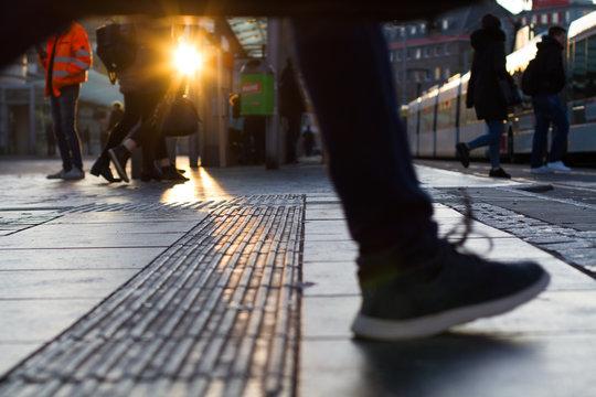Rush hour at sunrise at tram/bus station