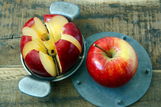 An apple slicer on wooden table