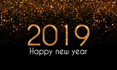 2019 Happy New Year card with gold, sparkle numbers and white text,  golden bokeh lights on black background. New Year's eve glam illustration with glitter falling