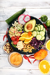 grilled tofu and dragon fruit buddha bowl with vegetable and humus