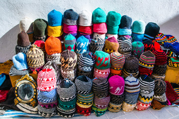Multicolored handmade moroccan caps in the Medina of Essaouira in Morocco, Africa