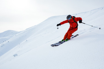 Fototapete - A man is skiing on the slope.