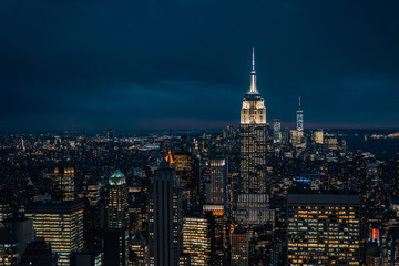View of the Empire State Building and Midtown Manhattan skyline at night, in New York City