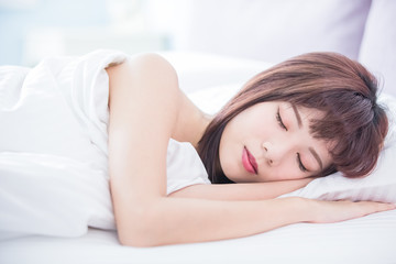 woman sleeping well in bed Wall mural