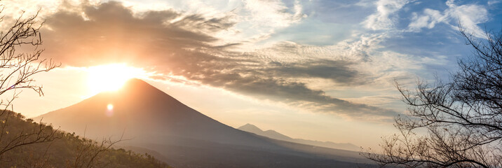 Panoramic beautiful view view of the mountains at sunset. evening cloudy view of the volcano Аgung, Bali