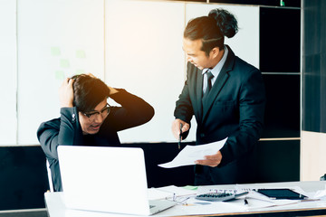 Boss shouting to employee while mistake working.
