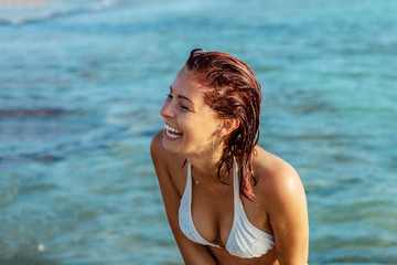 Young woman laughing in the water