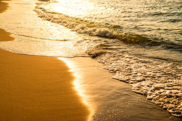 surf of the Baltic sea with evening sun