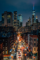 View of the Lower East Side and Financial District at night, from the Manhattan Bridge in New York City