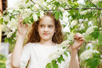 Princess girl breathing a apple flower
