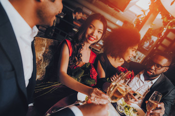 Group Happy Friends Enjoying Dating in Restaurant