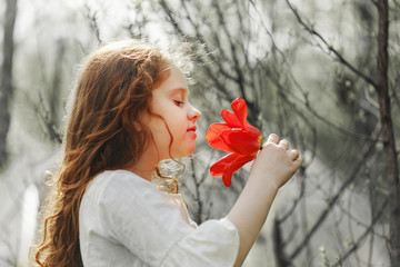 Girl with tulip flower, photo in the profile.