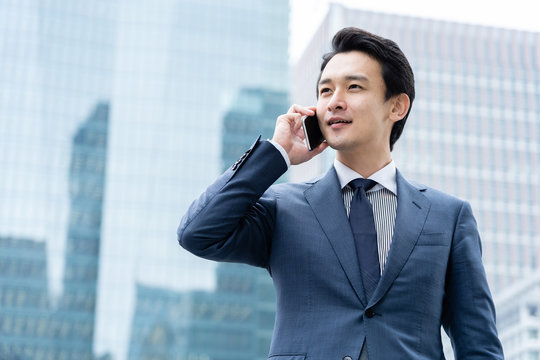 portrait of young asian business person standing in  front of building