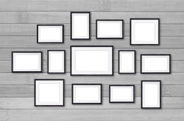 Photo frames collage, interior decor mock up, thirteen black frameworks on wooden wall, gallery style.