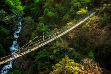 Nepal suspension bridge sherpa