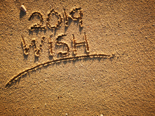2019 Wish. New Year concept. The inscription 2019 on a sand beach. Winter holidays concept. Top View. Space for text– stock image. Conceptual photo New Year Celebration Motivation.