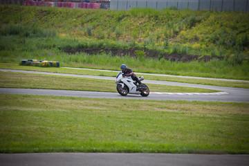 Moto-athlete on the racetrack.