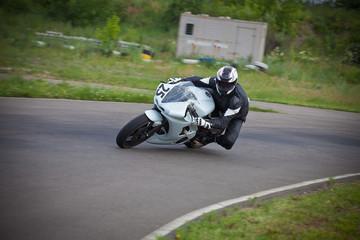 Motorcyclist enters a dangerous turn.