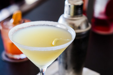 Lemon Drop Martini with Sugared Rim and Shaker at Bar