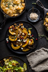 Roasted Butternut Squash on Dark Background with Harvest Foods