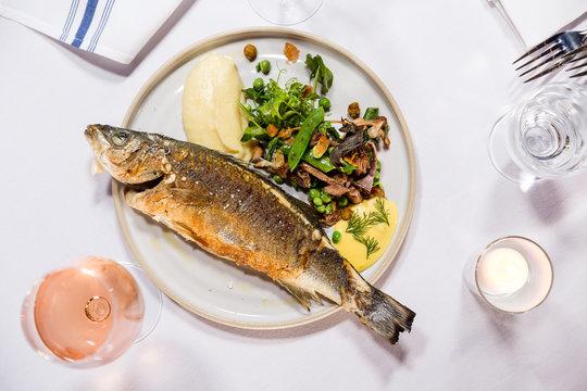 Whole Pan Fried Pacific Rockfish with Potato Puree and Snap Pea and Mushroom Salad