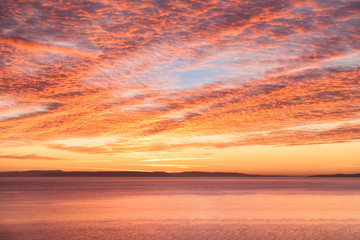 Sunrise Mackeral Sky with Cirrocumulus Clouds over the Sea