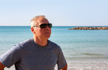 Portrait of a man of retirement age on the background of the sea
