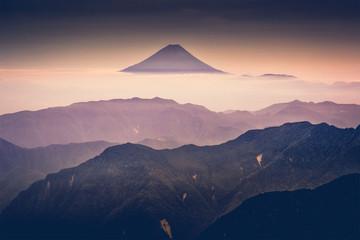Mt.Fuji through the mist with the twilight sky after sunrise from Kitadake, Minami South Alps, Japan