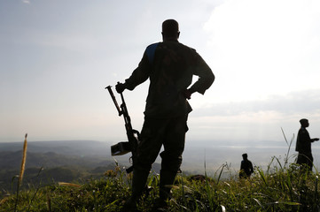 Soldiers stand in an FARDC field camp in Paida near Beni