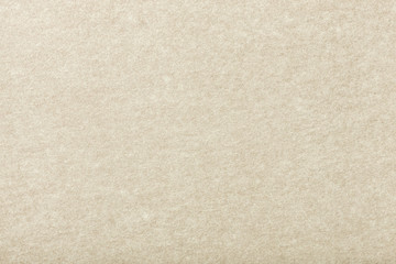 Light beige matt suede fabric closeup. Velvet texture of felt.