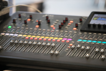 The audio equipment, control panel of digital studio mixer, side view. Close-up, selected focus
