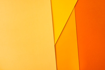 Background of shape and geometry. Colored background decorations with paper. Shades of yellow.