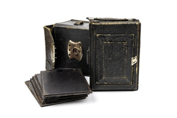 Vintage camera, glass plates and leather case. The first Soviet camera, 1930, isolated on a white background.