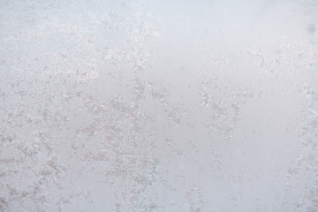 Background ice on the glass. Frost. The texture of frost. The glass is frozen.