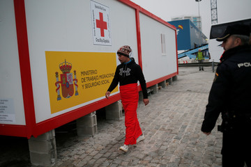 A migrant walks after arriving on a rescue boat at the port of Malaga
