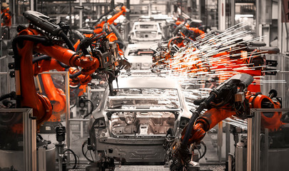 The robotic arm of the car production plant is working