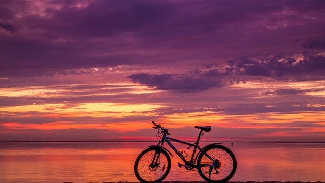 silhouette of bicycle on sunset